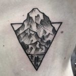 Cliff in a triangle tattoo