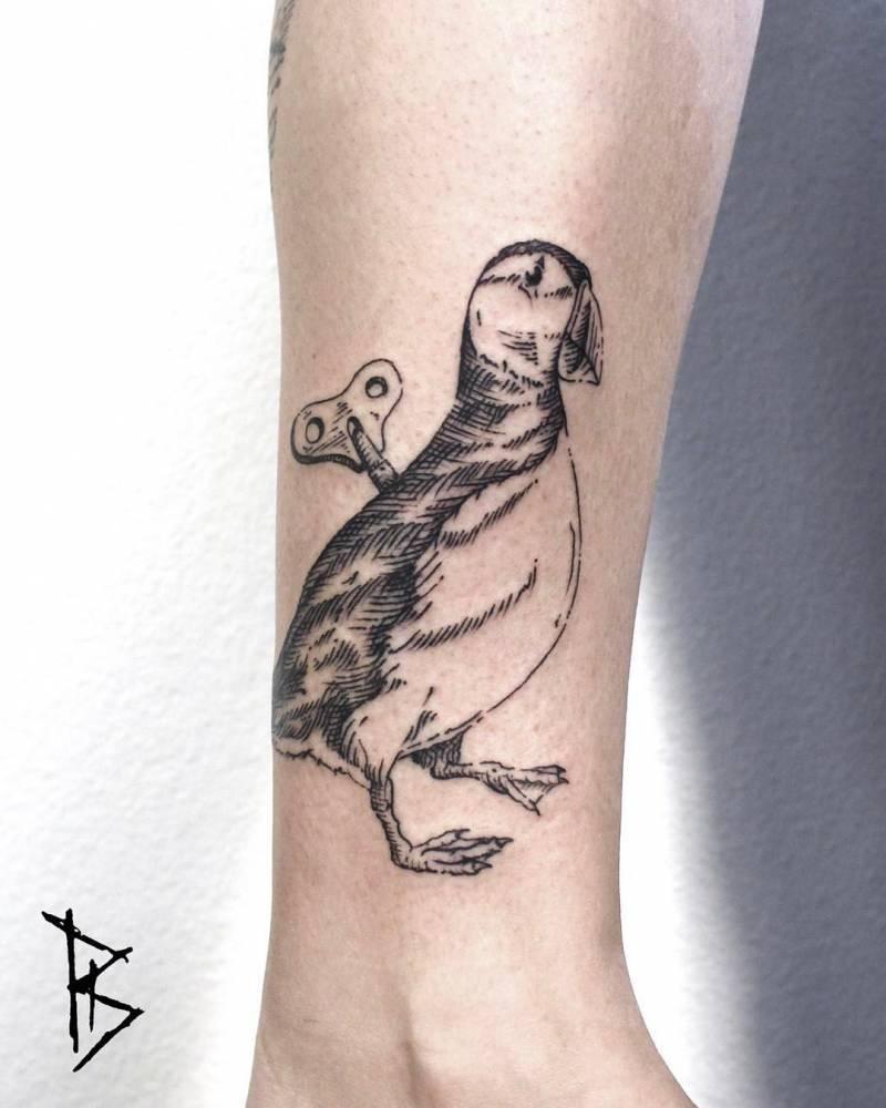 Clockwork mallard tattoo by Loïc Lebeuf