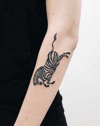 Cool zebra tattoo on the forearm