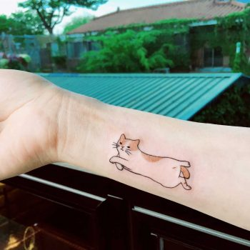 Cute jumping cat tattoo