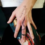 Cute snake tattoo on the middle finger