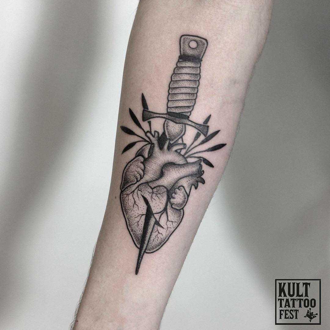 Dagger pierced heart done at Kult Tattoo Fest