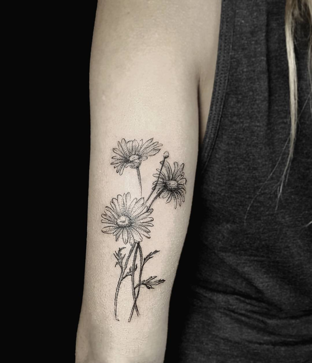 Daisies tattoo on the triceps