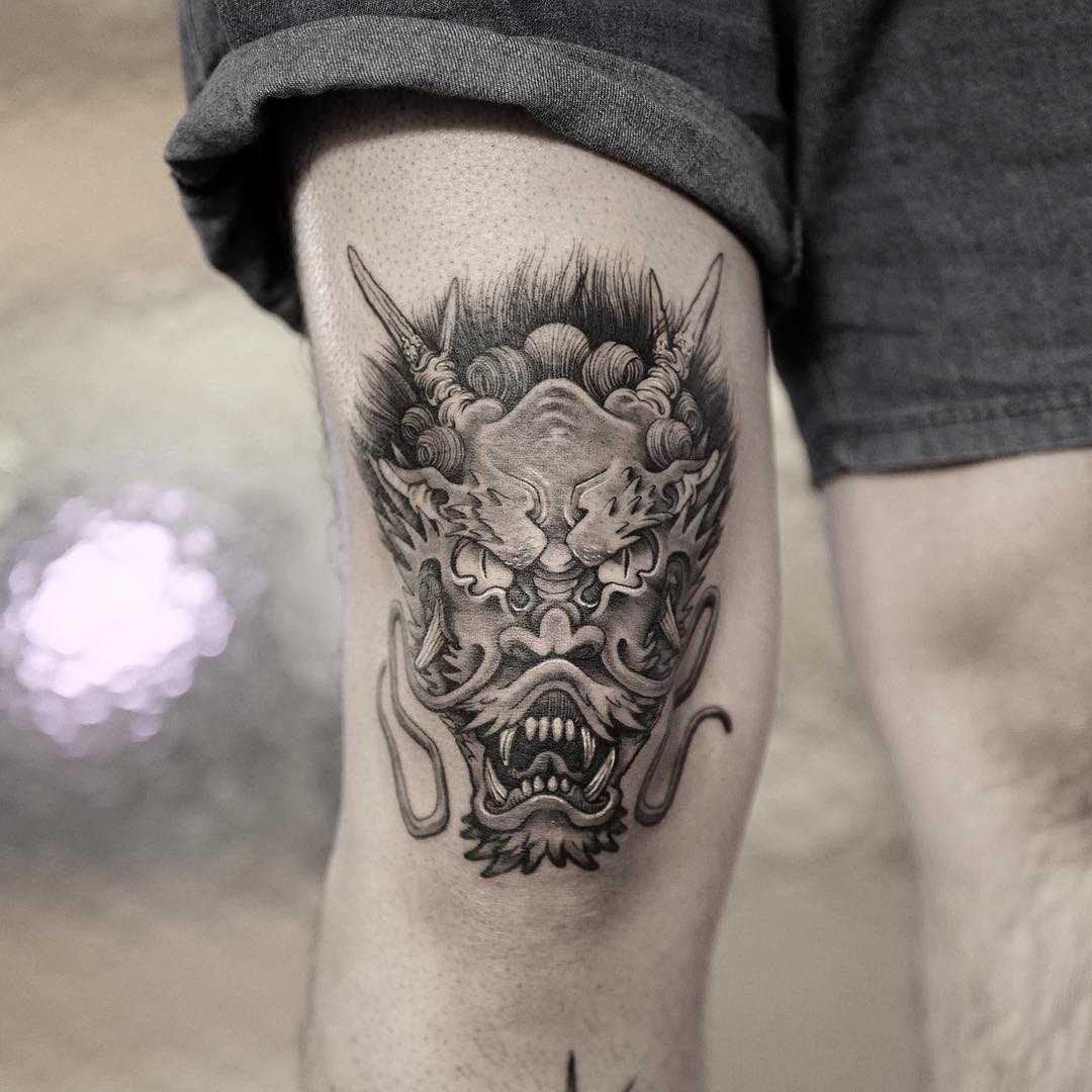 Devil tattoo on the thigh