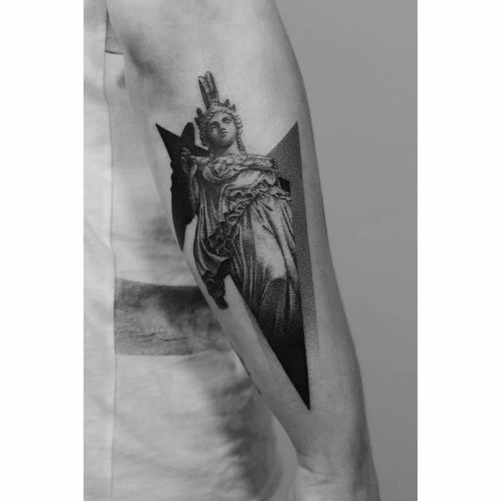 Dot-work Athena tattoo
