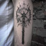 Double axe tattoo on the forearm