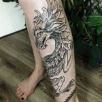 Dragon tattoo on the left calf