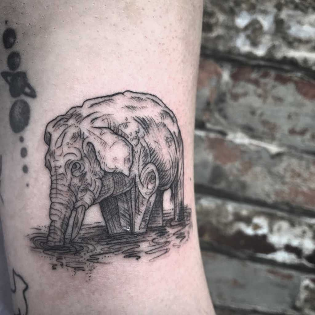 Drinking elephant tattoo