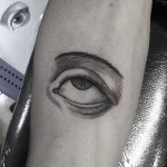 Etching eye tattoo done at Primordial Pain Tattoo, Milano