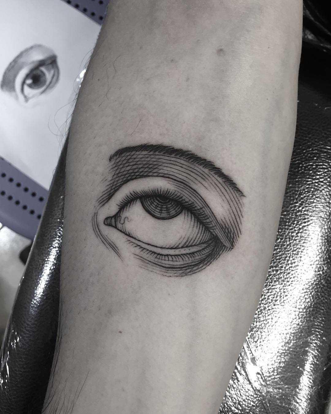 Etching eye tattoo done at Primordial Pain Tattoo, Milano