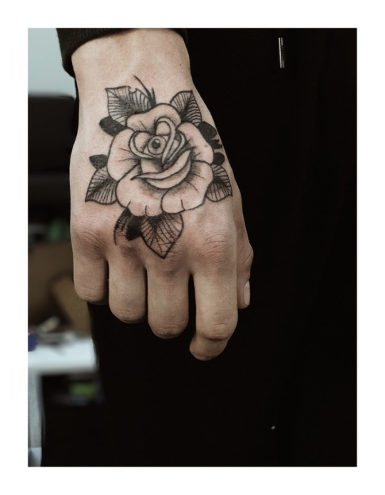 Eye of rose tattoo
