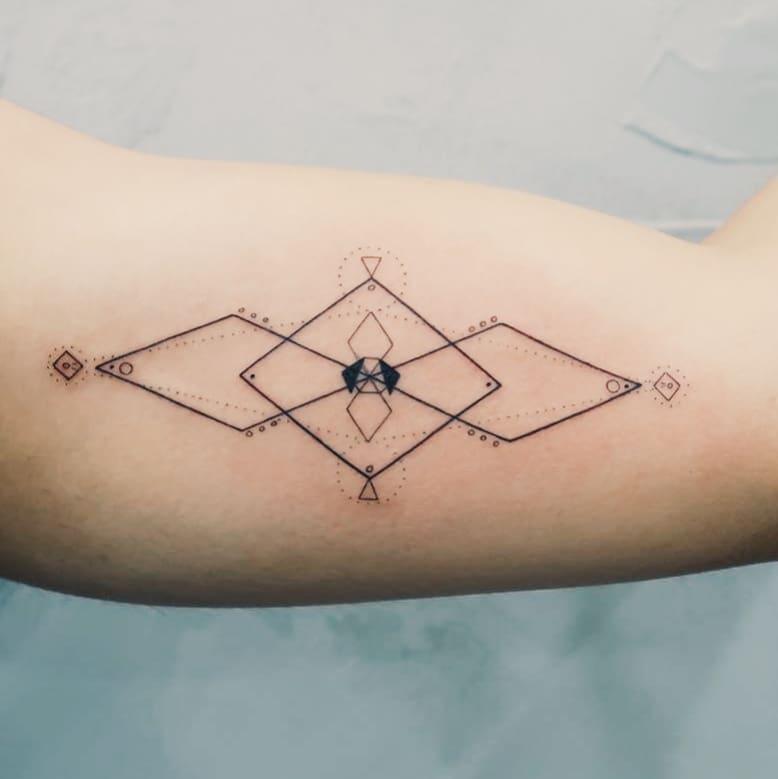 Fine line shapes tattoo by artist Cholo