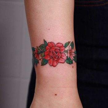 Floral bracelet done at High Tension Tattoo