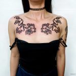 Flower tattoos on the collarbone