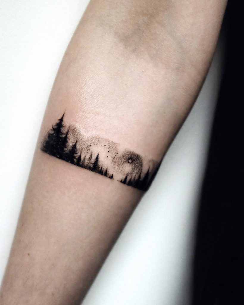 Forest armband tattoo on the forearm