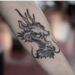 Funky dragon tattoo by Jonas Ribeiro