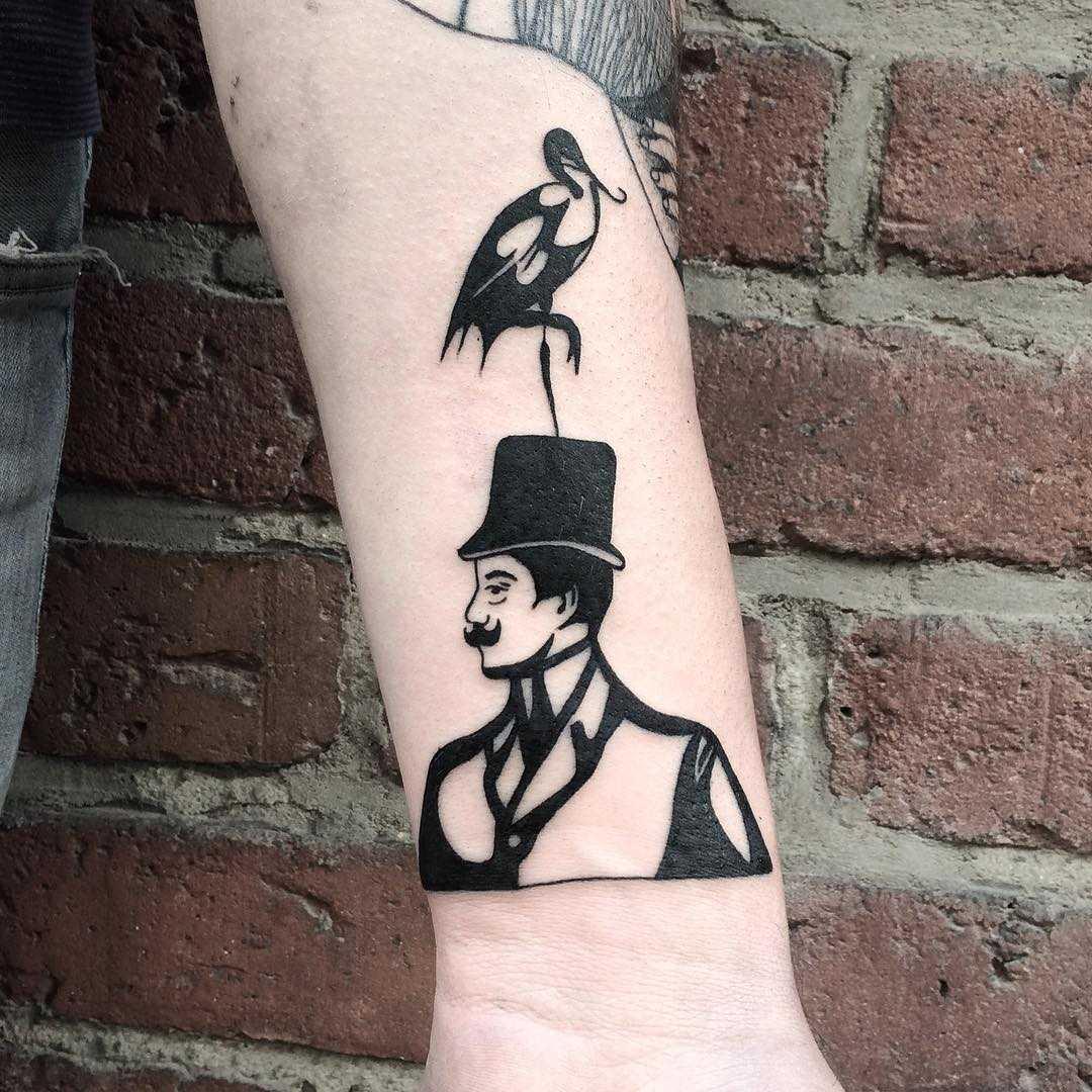 Gentleman and bird tattoo