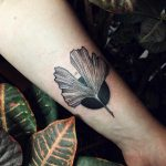 Ginkgo leaf and a black circle tattoo