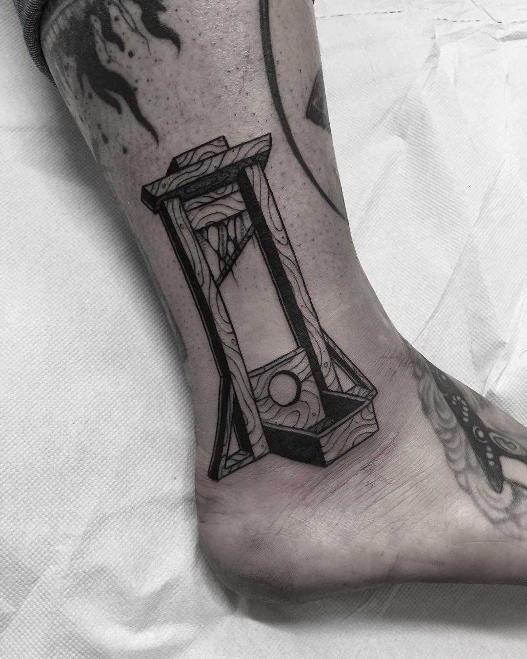 Guillotine tattoo done at Primordial Pain Tattoo