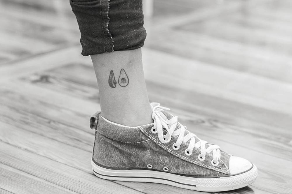 Hand-poked avocado tattoo on the ankle