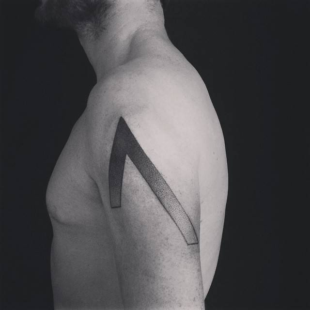 Hand-poked sharp edge geometric shape tattoo