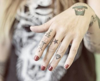 Hand-poked sword tattoo on the finger