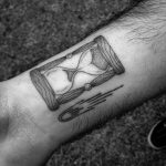 Hourglass and comet tattoo
