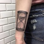 Hourglass on the forearm done at Kult Tattoo Fest