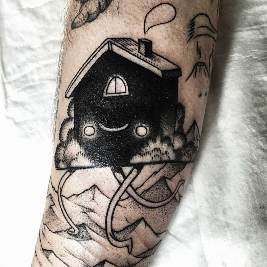 House with legs tattoo