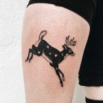 Jumping deer tattoo on the calf