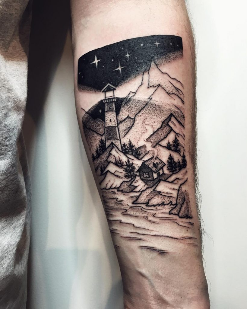 Lighthouse and mountains tattoo