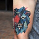 Lion head and cosmic triangle tattoo