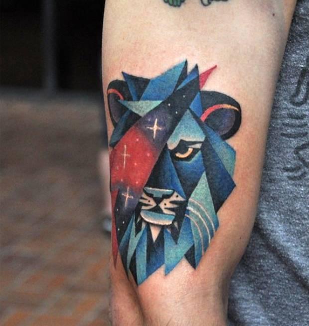 Lion head and cosmic triangle tattoo