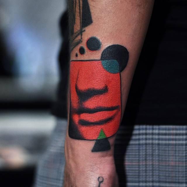 Lips and nose tattoo by David Côté