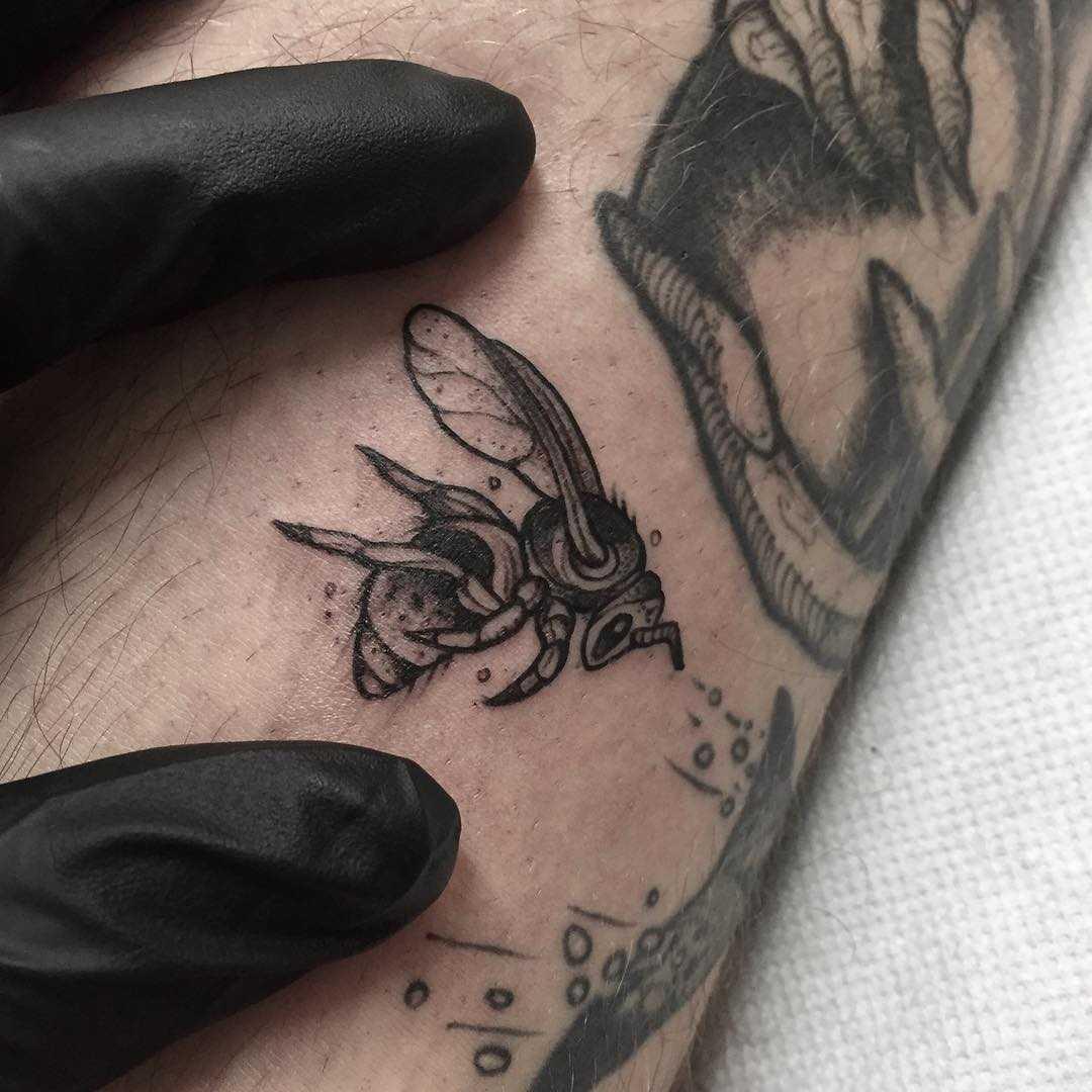 Little black wasp tattoo