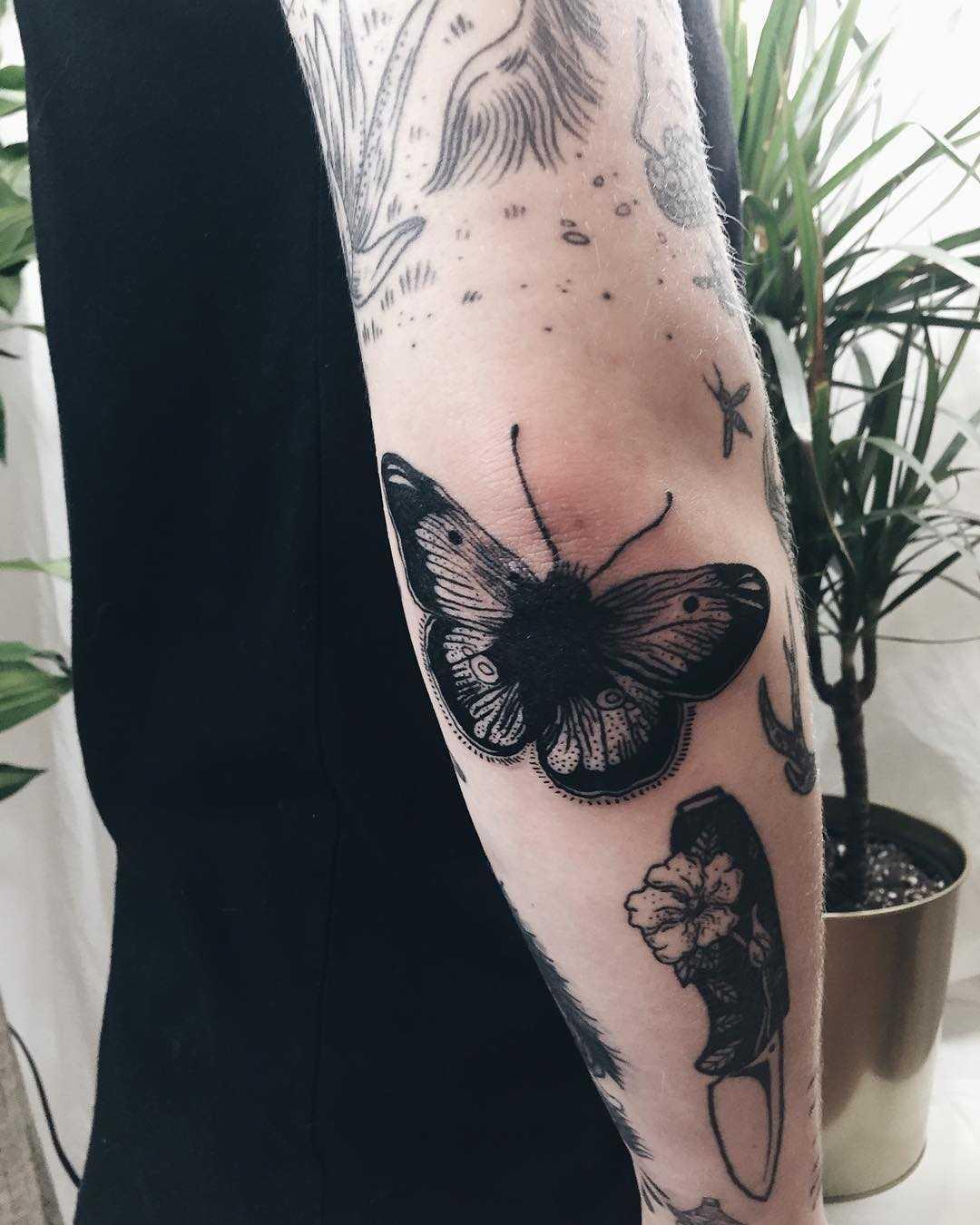 Little butterfly tattoo on the elbow