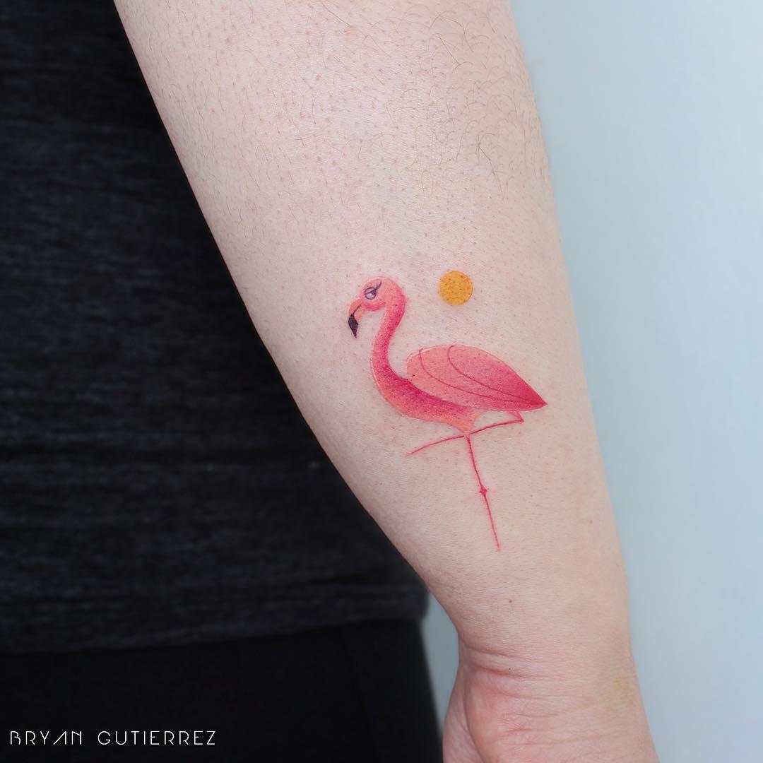 Little flamingo and sun tattoo