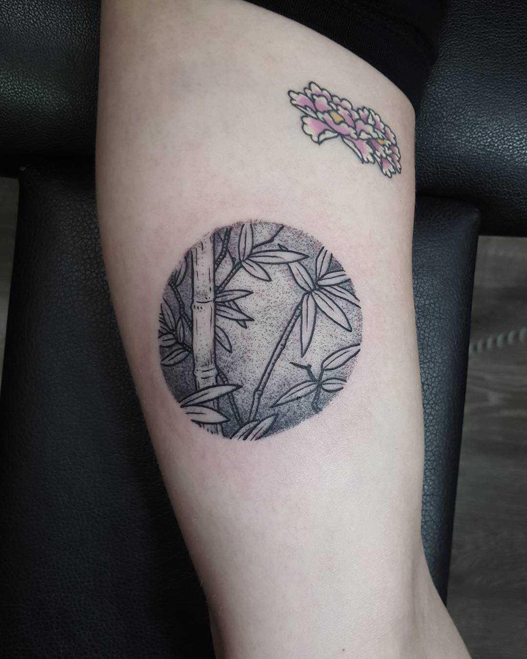 Little jungle scenery tattoo