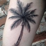 Little palm tree tattoo on the inner arm