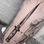 Long dagger tattoo