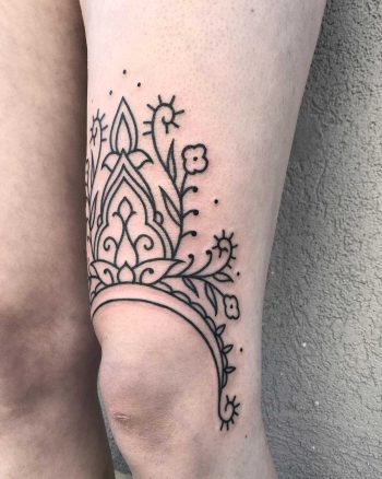Lovely ornament tattoo on the left thigh