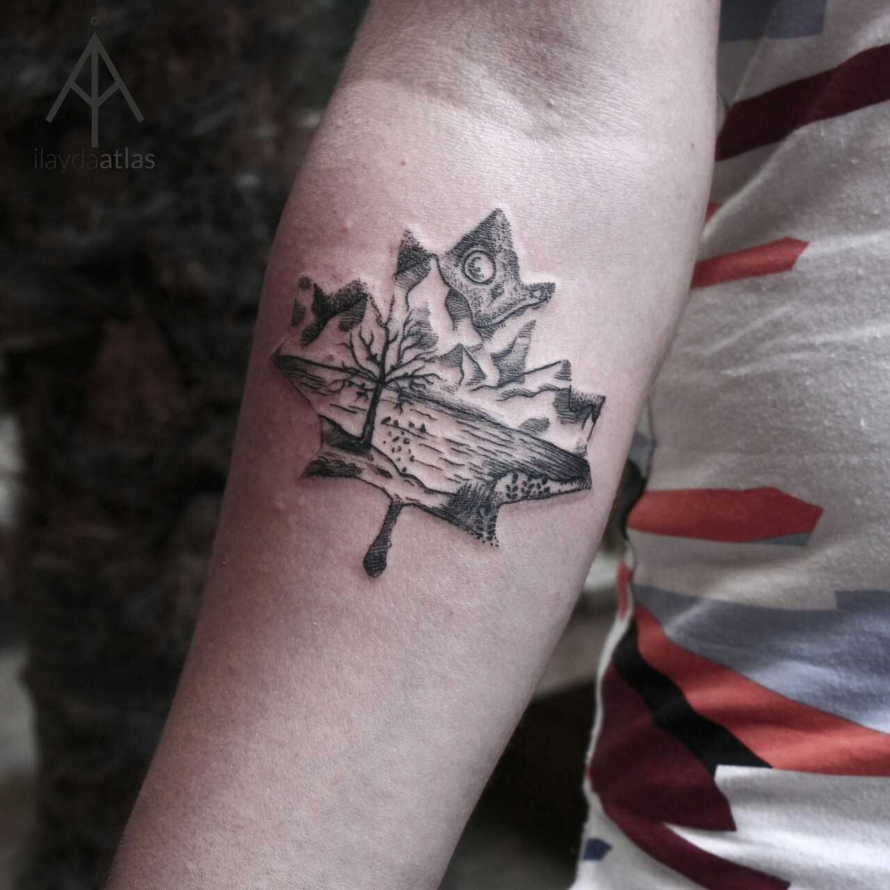 Maple leaf landscape tattoo