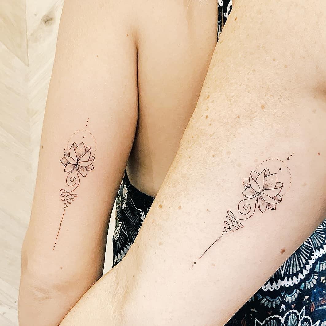 Matching Unalome tattoos by artist Cholo