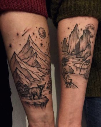 Matching landscape tattoos on forearms