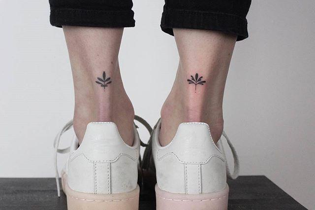 Matching lotus tattoos on ankles