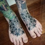 Matching mandala tattoos on feet