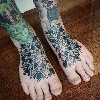 Matching mandala tattoos on feet