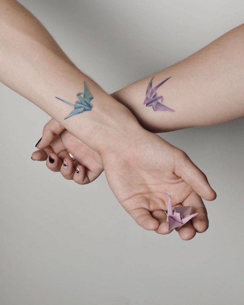 Matching paper crane tattoos