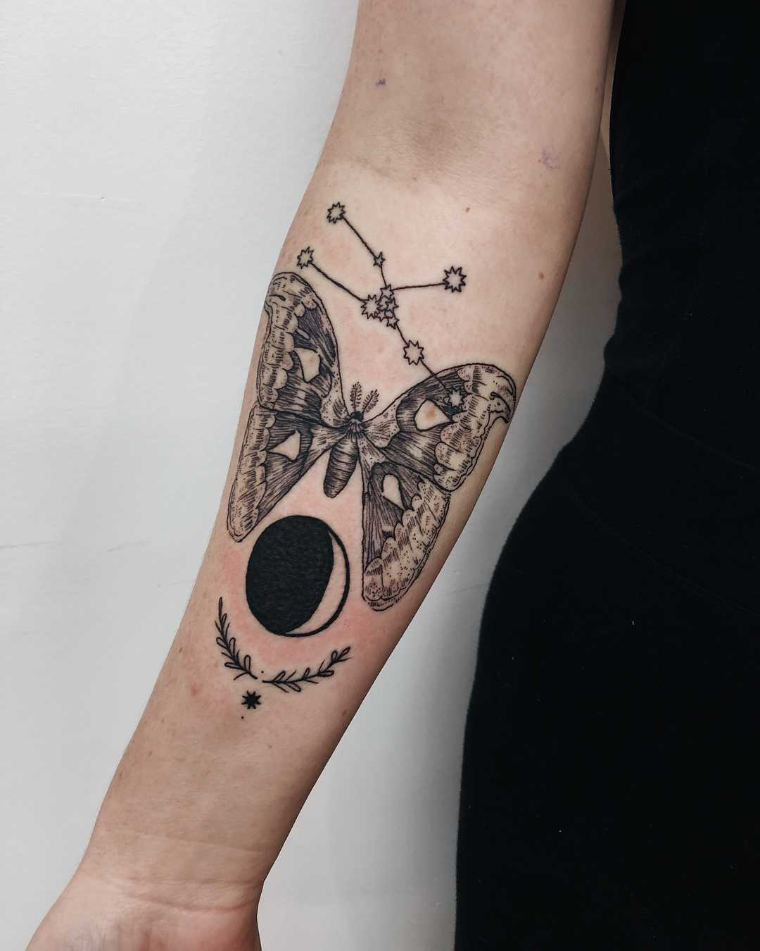 Moon and butterfly tattoos