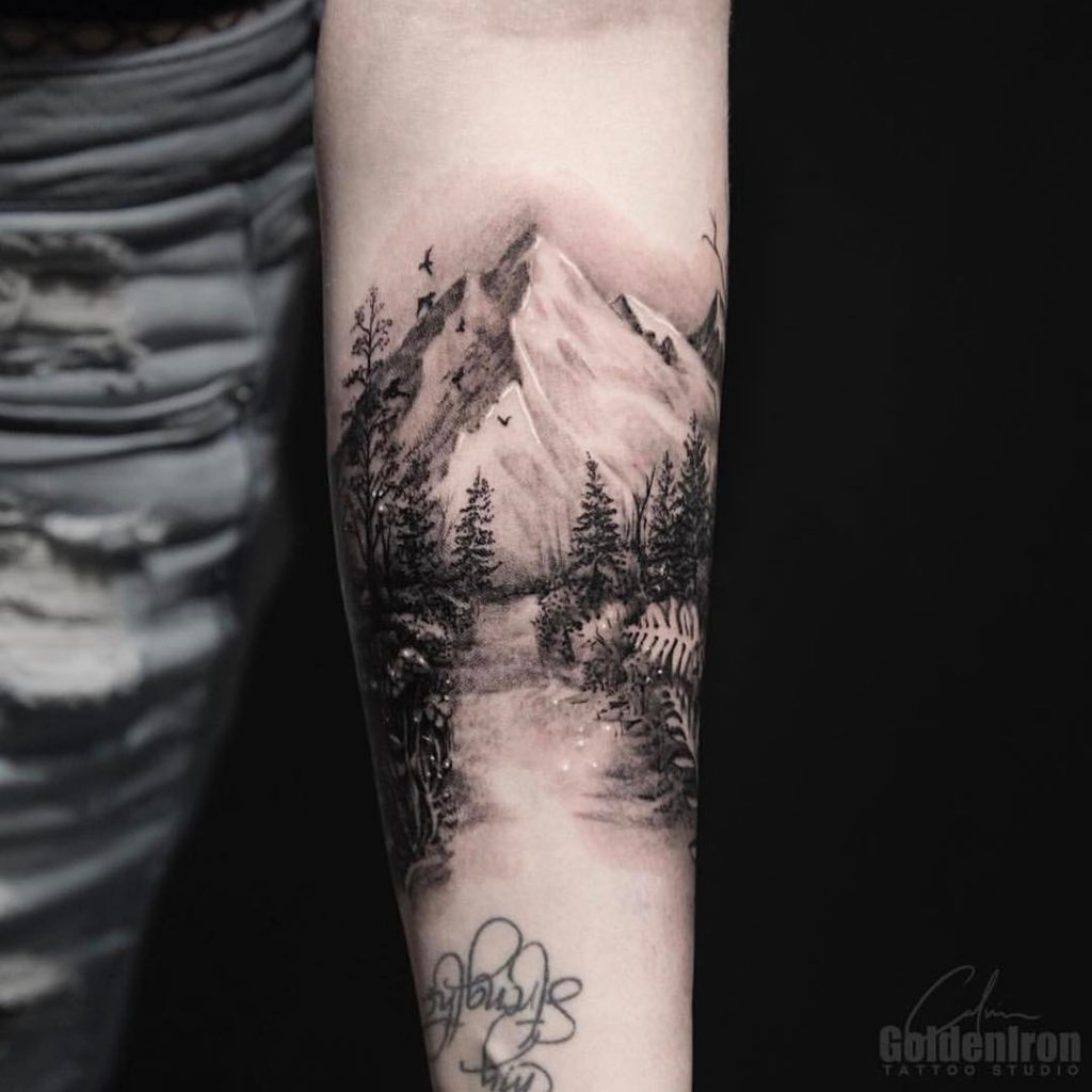 Mountainous landscape tattoo by Calvin Grxsy